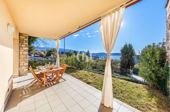 Apartment with veranda and garden with lake view